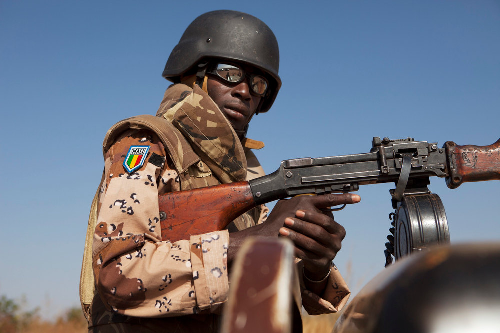 Description of . A Malian soldier stands guard as Mali's President Dioncounda Traore visits French troops at an air base in Bamako, Mali January 16, 2013. REUTERS/Joe Penney