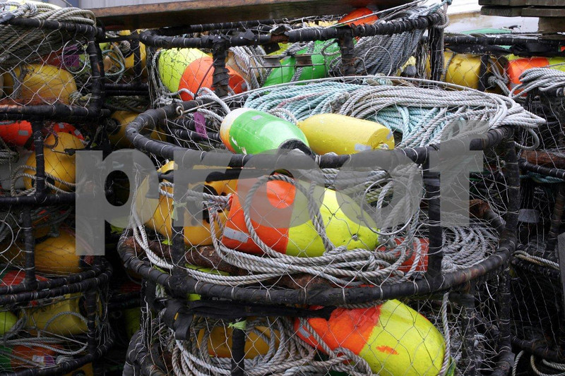 Crab pots stacked on dock.