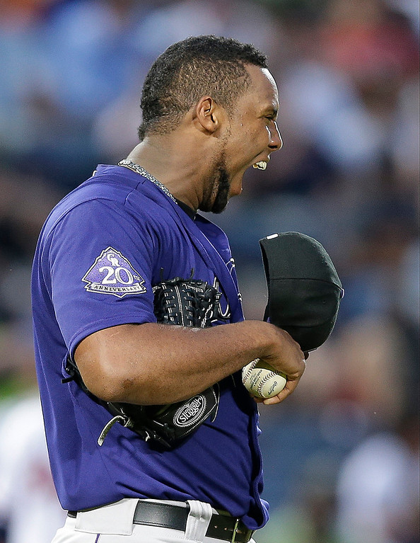 . Colorado Rockies starting pitcher Juan Nicasio reacts after giving up a hit in the fourth inning of a baseball game against the Atlanta Braves in Atlanta, Tuesday, July 30, 2013. (AP Photo/John Bazemore)
