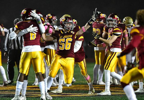 12/14/2019 Mike Orazzi | Staff St. Joseph High School's Kenny Martin (56) celebrates a 17-13 win over Daniel Hand at Veteran's Stadium in New Britain on Saturday.