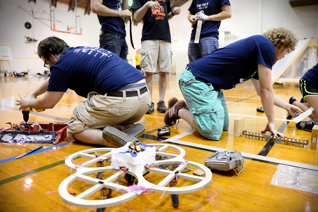 ". The Cunning Stunts get ready for their final round as mechanical engineering Caltech students compete in the annual ME72 Engineering Design Contest at the Pasadena campus Tuesday, March 11, 2014. The goal in ""Raiders of the Lost Can\"" was to move their team\'s can closest to the center of a platform. (Photo by Sarah Reingewirtz/Pasadena Star-News)"