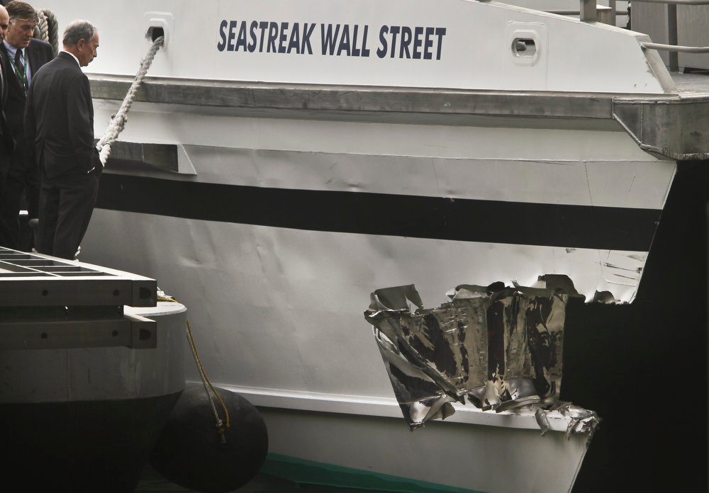 . Mayor Michael Bloomberg surveys the damage to a passenger ferry after it crashed on Wednesday, Jan. 9, 2013 in New York.  At least 50 people were injured, two critically, when a commuter ferry struck a dock in New York City\'s financial district, ripping open a right-side front corner. (AP Photo/Bebeto Matthews)