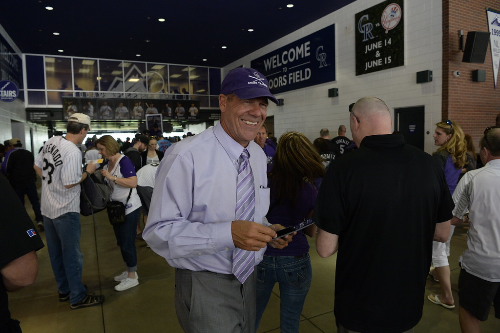 . Charlie Monfort hands out calendars to fans entering Coors Field before the game. The Colorado Rockies played the San Diego Padres Friday, April 8, 2016 on opening day at Coors Field in Denver, Colorado. (Photo By Andy Cross/The Denver Post)