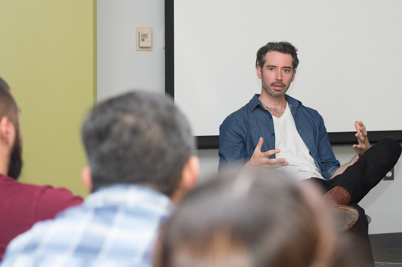 Andrew Pastides lead actor in the film 'MA' speaks to students in the