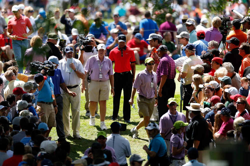 . Tiger Woods walks from the fourth green to the fifth tee while surrounded by fans during the Final Round of the World Golf Championships-Bridgestone Invitational at Firestone Country Club South Course on August 4, 2013 in Akron, Ohio.  (Photo by Gregory Shamus/Getty Images)