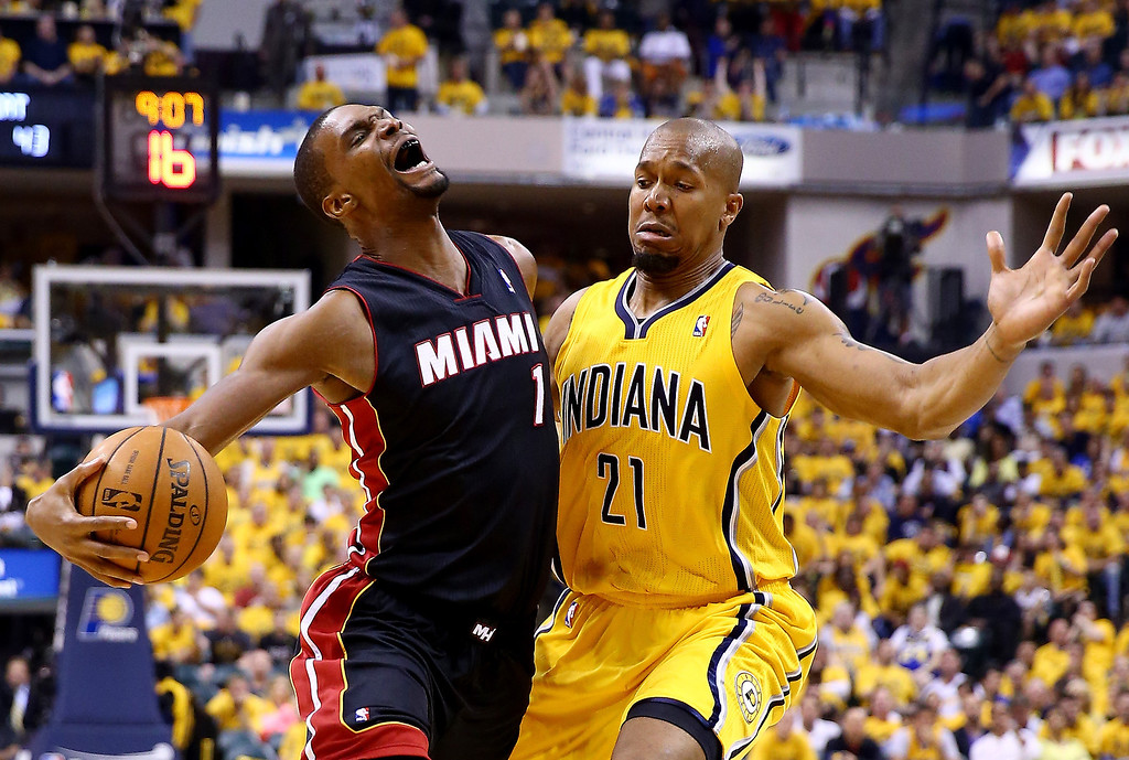 . Chris Bosh #1 of the Miami Heat goes to the basket as David West #21 of the Indiana Pacers defends during Game Two of the Eastern Conference Finals of the 2014 NBA Playoffs at at Bankers Life Fieldhouse on May 20, 2014 in Indianapolis, Indiana.   (Photo by Andy Lyons/Getty Images)