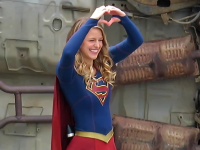 EXC: Supergirl Gives The Heart Sign To Her Crew!