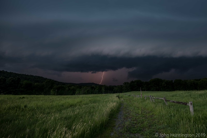A severe thunderstorm approaches a Hudson Valley field.