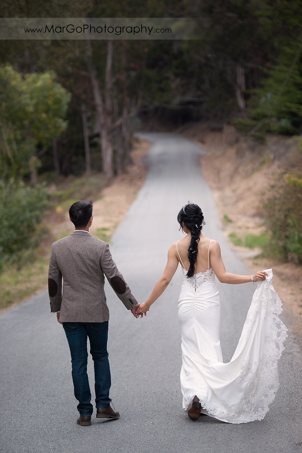 bride and groom holding hands and walking away at Long Branch Saloon & Farms in Half Moon Bay
