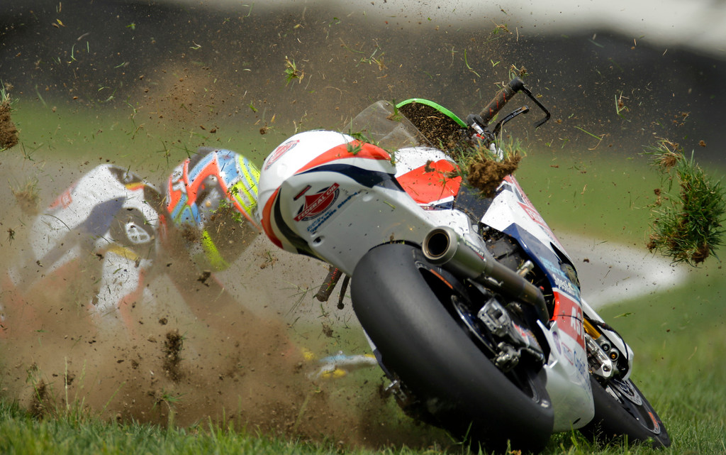 . Xavier Simeon, of Belgium, crashes during Indianapolis Moto 2 motorcycle race at the Indianapolis Motor Speedway in Indianapolis, Sunday, Aug. 10, 2014. (AP Photo/Michael Conroy, File)