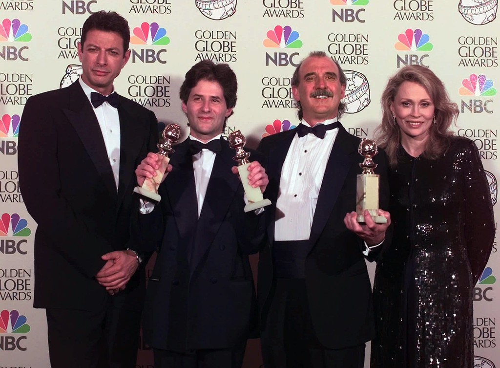 ". Jeff Goldblum, far left, and Faye Dunaway, far right, pose after presenting James Horner, second from left, and Will Jennings the award for Best Original Song for ""My Heart Will Go On\"" at the 55th Annual Golden Globe Awards in Beverly Hills, Calif., Sunday, Jan. 18, 1998.  The song is from the motion picture \""Titanic.\"" (AP Photo/Mark J. Terrill)"