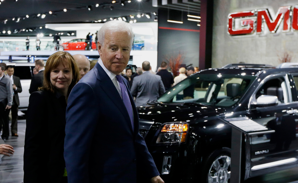 . Vice President Joe Biden and General Motors CEO Mary Barra look over the GM display during a tour of the North American International Auto in Detroit, Thursday, Jan. 16, 2014. Biden said the U.S. auto industry\'s resurgence since the 2009 federal bailout provides a strong basis for a Motor City recovery.  (AP Photo/Carlos Osorio)