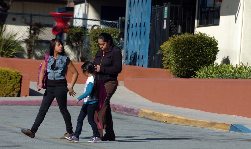 . Parents pick up their kids at Mentone Elementary School as it was placed on lock down due to police activity of Christopher Dorner in the Big Bear area February 12, 2013.  ON13-Dorner-01-TRC (Thomas R. Cordova/Staff Photographer)