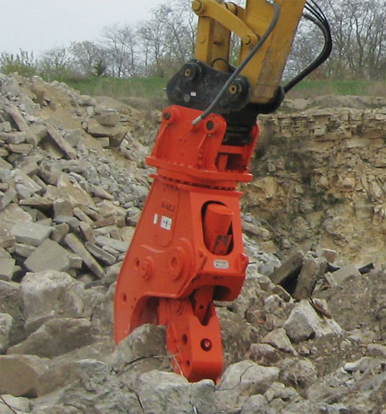 NPK U45JR concrete pulverizer on Cat excavator-crushing concrete (7).jpg