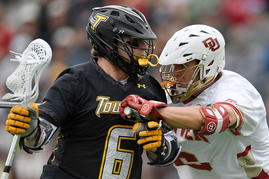 . DENVER, CO - MAY 15:  Sean Mayle (6) of the Denver defends Spencer Parks during the first half. University of Denver hosted Towson University in an NCAA tournament game on Sunday, May 15, 2016. (Photo by AAron Ontiveroz/The Denver Post)