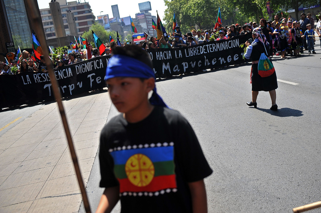 . Mapuche indigenous people march during a protest for the commemoration of Columbus Day in downtown Santiago, on October 12, 2013. HECTOR RETAMAL/AFP/Getty Images