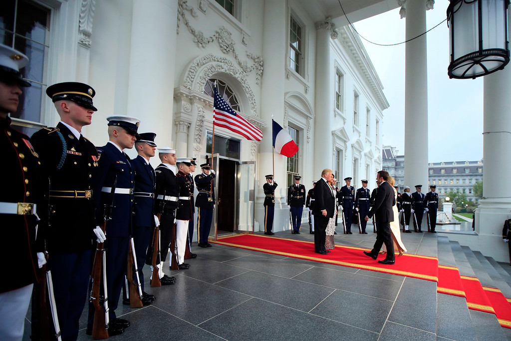 . President Donald Trump and first lady Melania Trump greet French President Emmanuel Macron and his wife Brigitte Macron on the North Portico for a State Dinner at the White House in Washington, Tuesday, April 24, 2018. (AP Photo/Manuel Balce Ceneta)