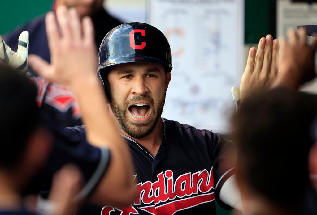 . Cleveland Indians\' Jason Kipnis celebrates his solo home run with teammates during the first inning of a baseball game against the Kansas City Royals at Kauffman Stadium in Kansas City, Mo., Friday, Aug. 18, 2017. (AP Photo/Orlin Wagner)