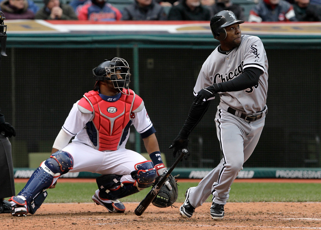 . Chicago White Sox\'s Alejandro De Aza watches the flight of his two-run home run in the sixth inning off Cleveland Indians relief pitcher Dan Wheeler in a baseball game in Cleveland on Wednesday, April 11, 2012. Also watching is Cleveland Indians catcher Carlos Santana.  (AP Photo/Amy Sancetta)