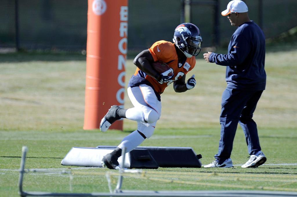 . Denver Broncos running back Montee Ball (28) runs through drills during practice November 13, 2013 at Dove Valley (Photo by John Leyba/The Denver Post)