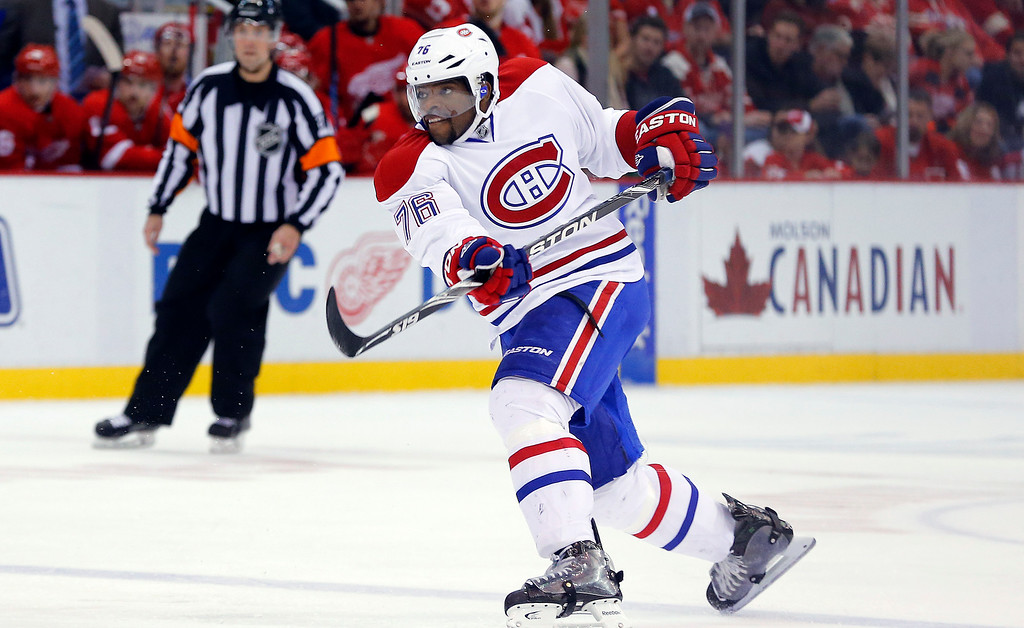 . Montreal Canadiens defenseman P.K. Subban (76) watches his shot that scored a goal against the Detroit Red Wings in the second period of an NHL hockey game in Detroit Sunday, Nov. 16, 2014. (AP Photo/Paul Sancya)