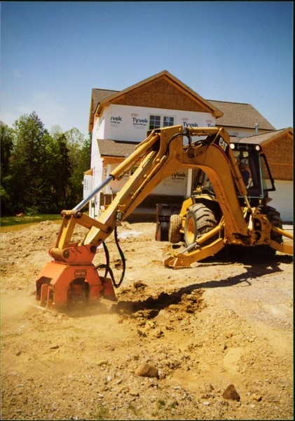 NPK C4C compactor with backfill blade on Cat backhoe (3).JPG