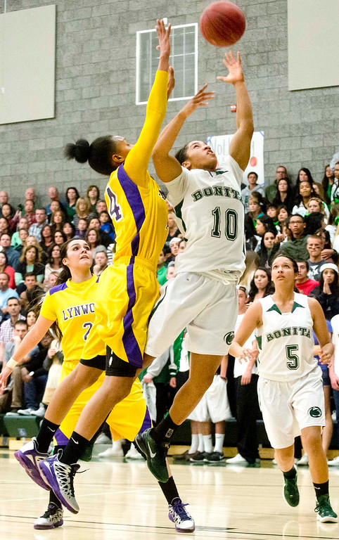 . Bonita\'s Nikki Wheatley (10) goes up for basket against Lynwood\'s Alize Losfton (14) in the second half of Bonita vs Lynwood CIF-SS Divisions 2AA girls basketball semifinals at Bonita High School in La Verne on Tuesday evening, Feb. 26, 2013. Lynwood won 60-47. (SGVN/Staff photo by Watchara Phomicinda)