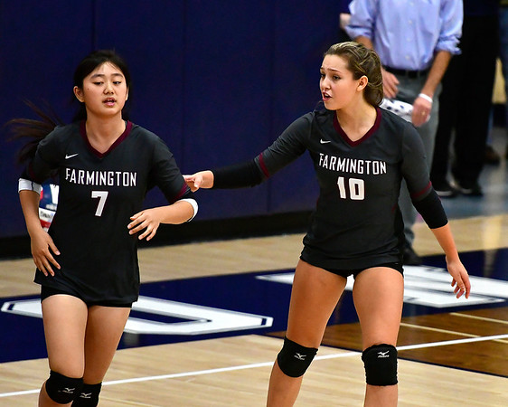 11/1/2018 Mike Orazzi | Staff Farmington High Schools Amy Jia (7) and Holly Picchioni (10) during the CCC Volleyball Tournament held at Avon High School Thursday night.