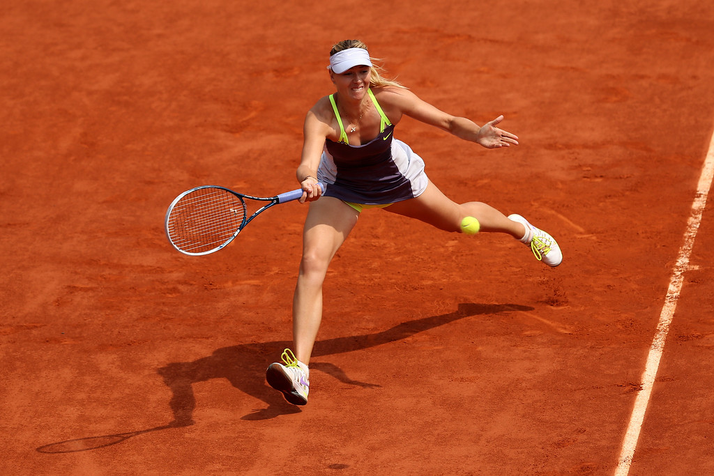 . Maria Sharapova of Russia plays a forehand in her Women\'s Singles Final match against Serena Williams of United States of America during day fourteen of French Open at Roland Garros on June 8, 2013 in Paris, France.  (Photo by Clive Brunskill/Getty Images)