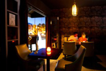 . Caption for Bar: Bar is Palm Springs newest hot spot with specialty drinks and late-night eats.