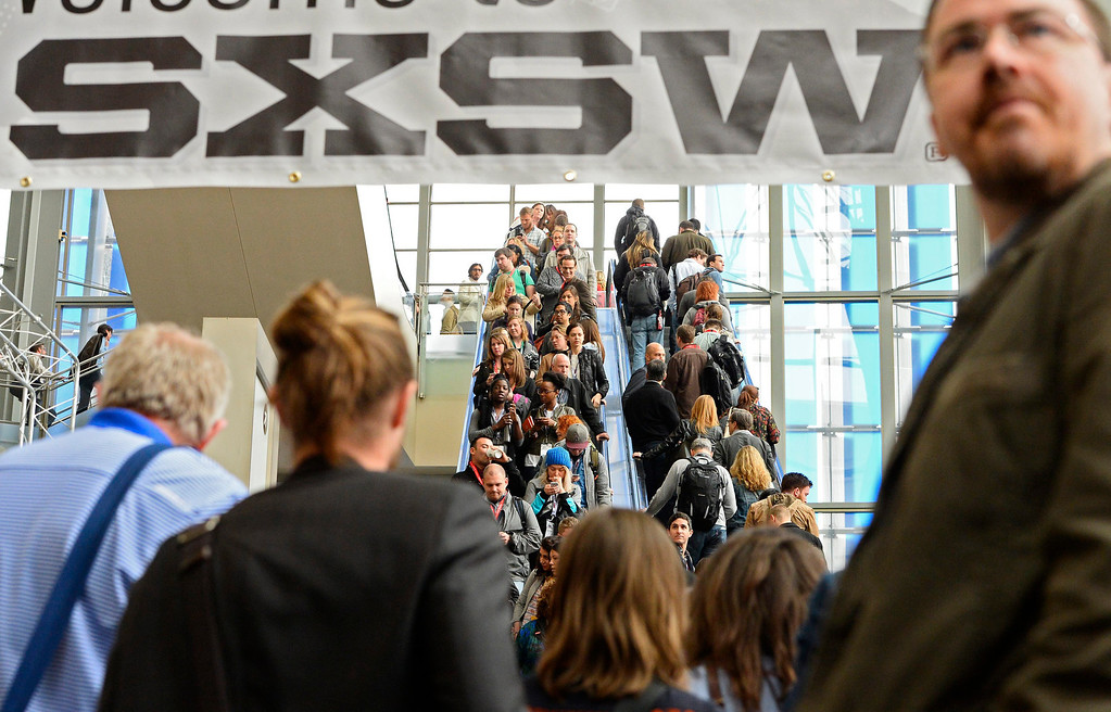 . Crowds move through the Austin Convention Center on the second day of South by Southwest in Austin, Texas, USA, 08 March 2014. South by Southwest (SXSW) Conferences and Festivals offer the unique convergence of original music, independent films, and emerging technologies.  EPA/LARRY W. SMITH