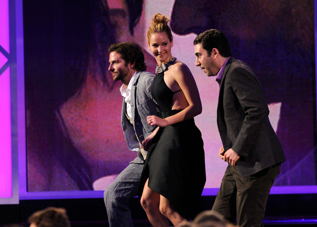 """. Actor Bradley Cooper, actress Jennifer Lawrence, and producer Jonathan Gordon accept the award for best feature for \""""Silver Linings Playbook\"""" at the Independent Spirit Awards on Saturday, Feb. 23, 2013, in Santa Monica, Calif. (Photo by Chris Pizzello/Invision/AP)"""