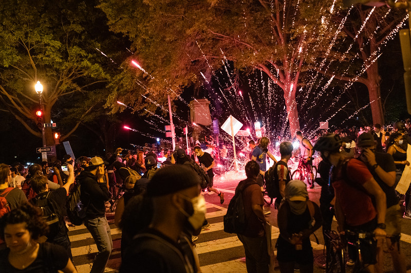 Protesters flee as a firework goes off near the White House during a clash with Secret Service over the death of George Floyd in Washington, DC on May 30, 2020.