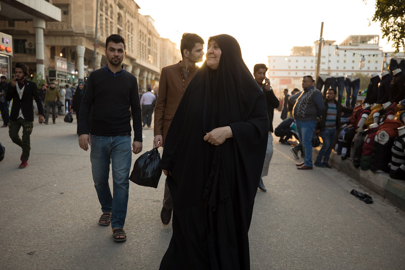 An Iraqi ladys dressed in a head-to-toe black chador in Najaf.