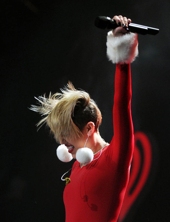 ". Miley Cyrus sings ""Party in the USA\""  at Xcel Energy Center in St. Paul, Tuesday, December 10, 2013. (Pioneer Press: Chris Polydoroff)"