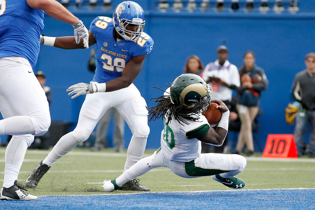 . Colorado State running back Dee Hart (10) dives into the end zone for a touchdown past San Jose State linebacker William Ossai (29) during the first half of an NCAA college football game Saturday, Nov. 1, 2014, in San Jose, Calif. (AP Photo/Tony Avelar)