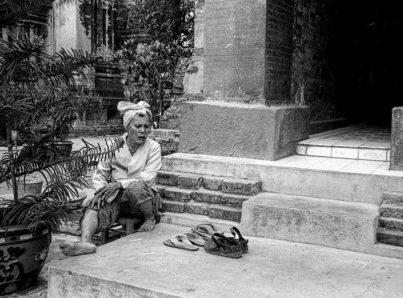 Woman sitting at entrance to Temple.jpg Blurb.JPG