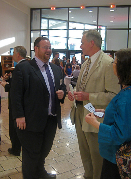 Friends member Rory Casey, Library chair for the 2010 Future Begins Here, talks with Terry Plum and his wife, May 2, 2010, at Holyoke Mall.
