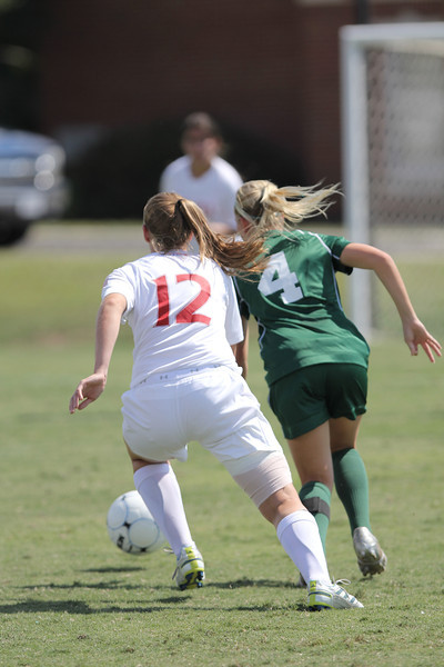 Shaylyn Poppe (12) fights for the ball against an opposing player.
