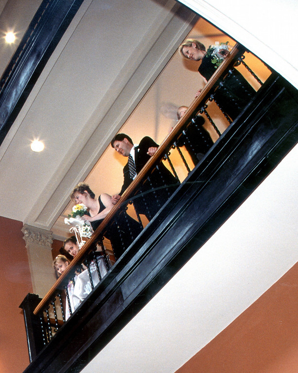 . Here\'s that ghostly apparition that appears to have been captured in this March 2001 photo of members of Kimberly and Joseph Arrigoni\'s wedding party, posing on the second-floor balcony of the Landmark Center. Is is the ghost of Jack Peifer? (Pioneer Press file photo)