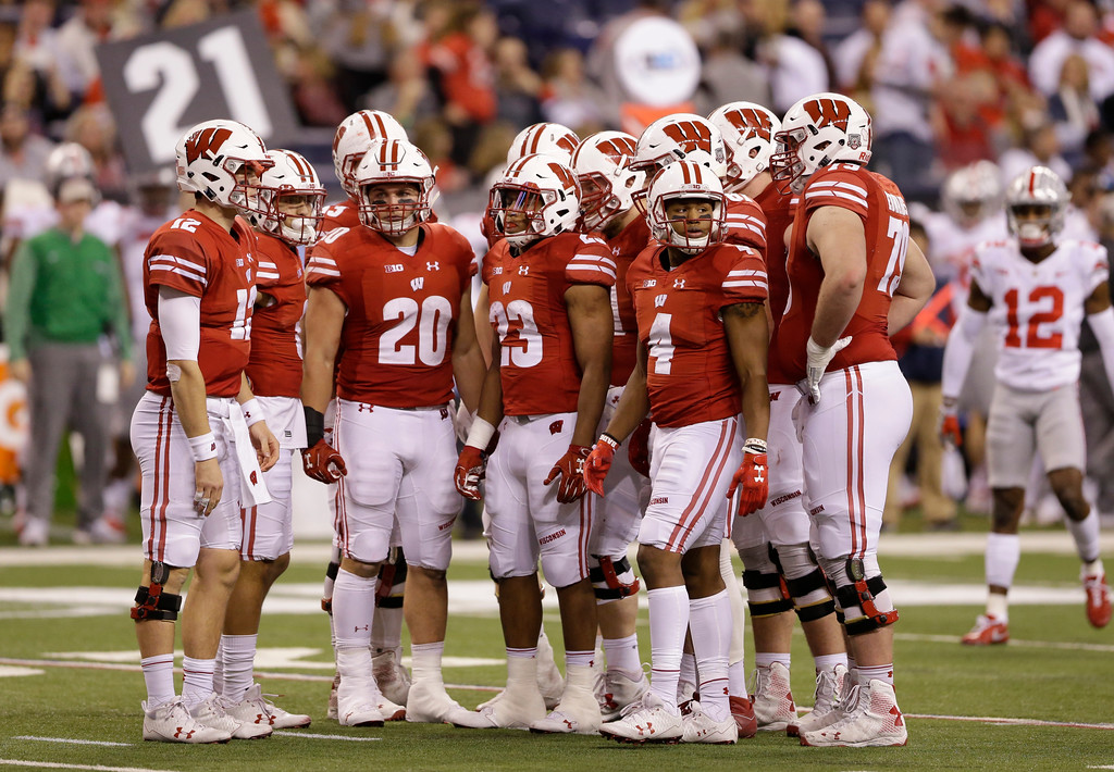 . Members of Wisconsin are seen during the second half of the Big Ten championship NCAA college football game against Ohio State, Saturday, Dec. 2, 2017, in Indianapolis. (AP Photo/AJ Mast)