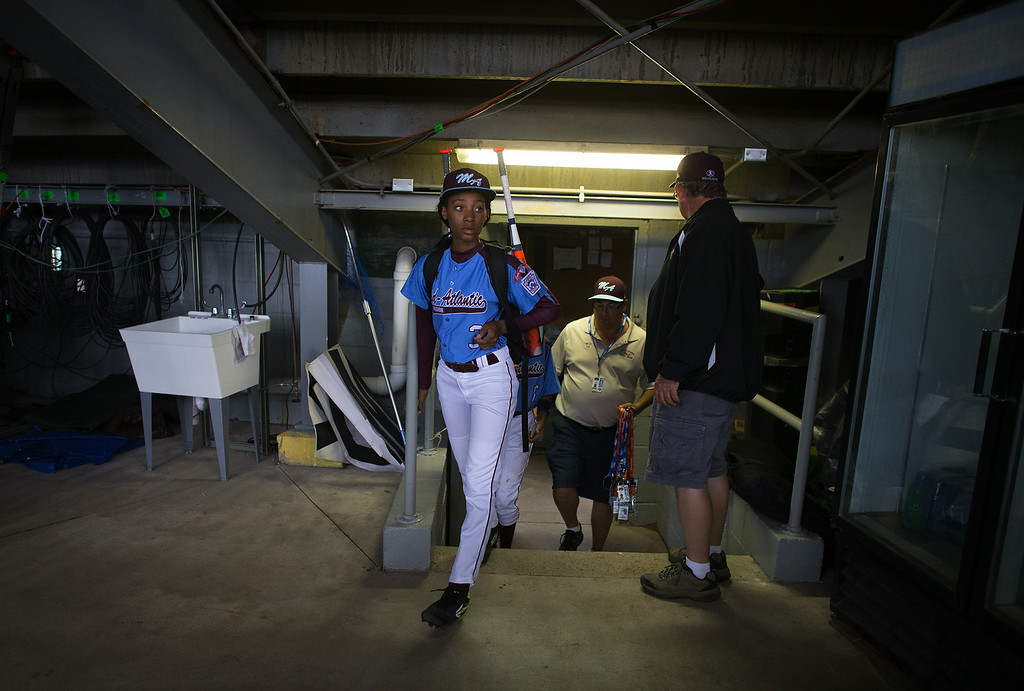 . Philadelphia\'s Mo\'ne Davis leaves the stadium after her team\'s 4-0 win over Nashville in a U.S. pool play baseball game at the Little League World Series, Friday, Aug. 15, 2014, in South Williamsport, Pa. (AP Photo/PennLive.com, Sean Simmers)
