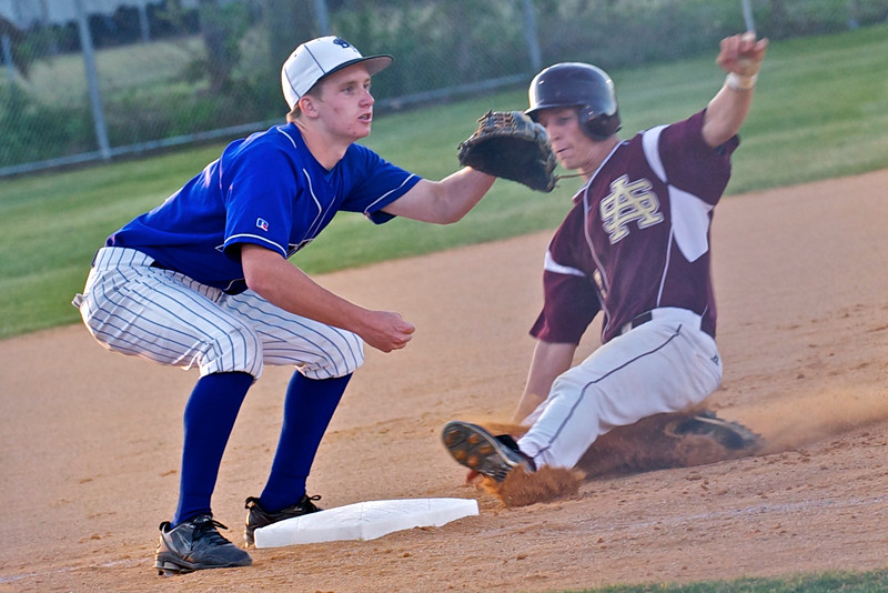 St. Augustine's Preston Kinlaw slides into third base as Bartram Trail's third baseman Trey Pickett waits for the ball during Tuesday's baseball game.