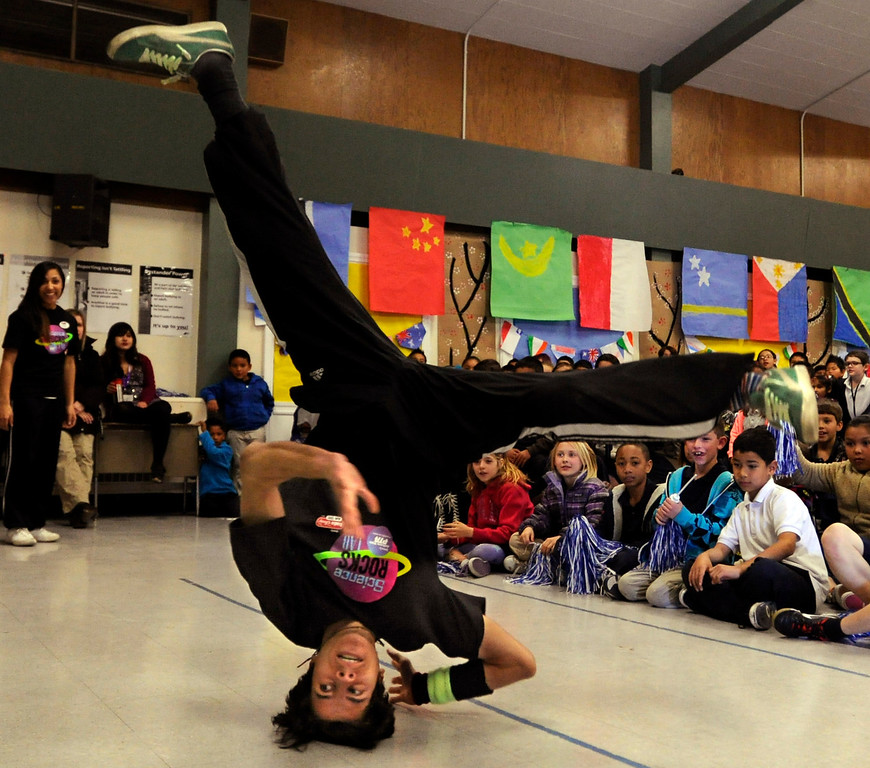 ". David Martinez, of San Francisco, performs a break dancing move at El Monte Elementary School as part of a ""Science Rocks\"" program in Concord, Calif., on Tuesday, Feb. 26, 2013. (Susan Tripp Pollard/Staff)"