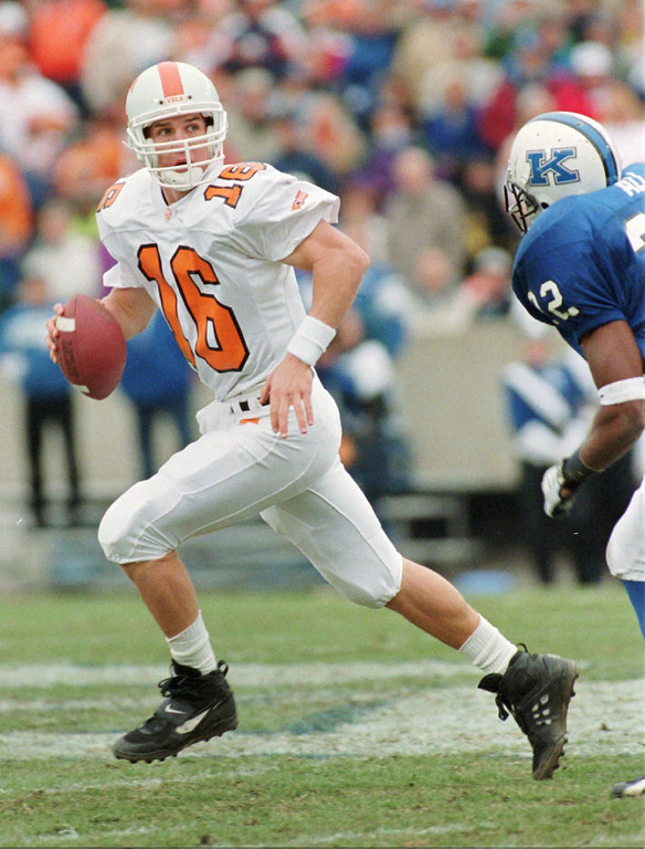 . Tennessee quarterback Payton Manning looks for a receiver as he is chased by Kentucky defender Dele Ali during the second quarter Saturday afternoon, Nov. 18, 1995, in Lexington, Ky.  Manning threw an incomplete pass..  (AP Photo/Ed Reinke)