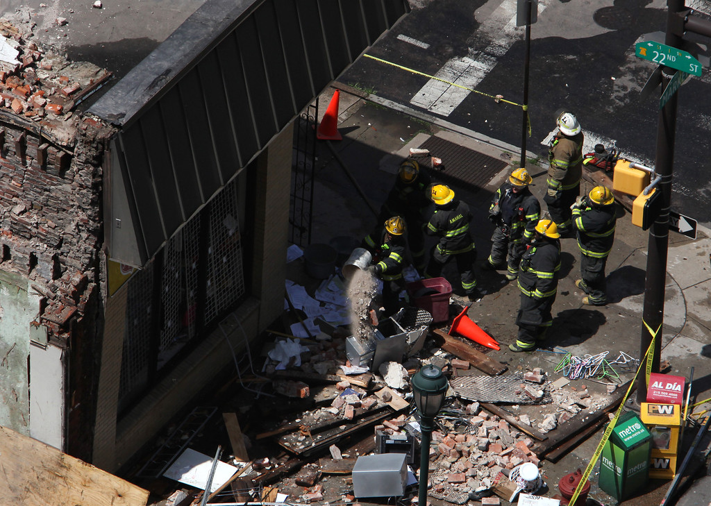 . Rescue personnel removed debris from the area of a collapsed building in downtown Philadelphia Wednesday June 5, 2013.    (AP Photo/Jacqueline Larma)