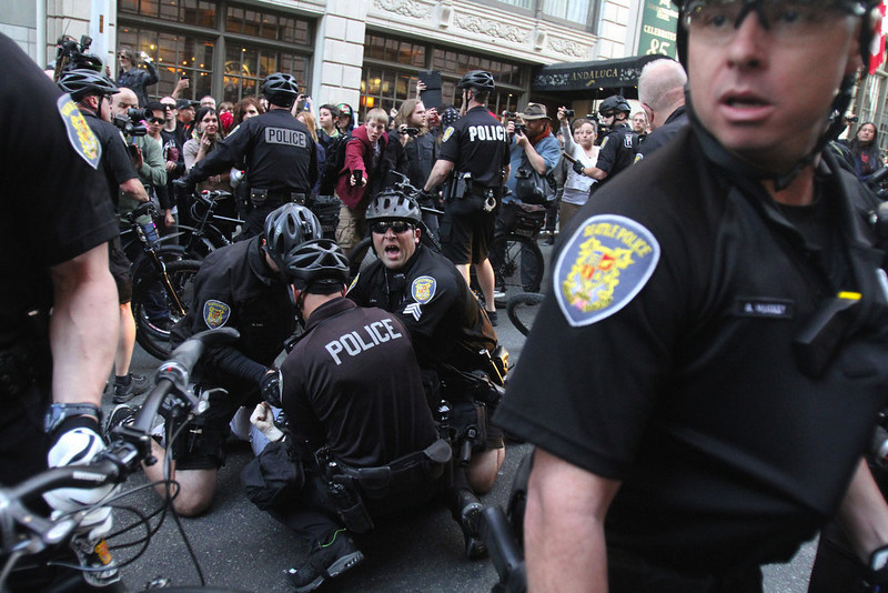 . Seattle Police make an arrest during a May Day march that began as an anti-capitalism protest and turned into demonstrators clashing with police Wednesday, May 1, 2013, in downtown Seattle. (AP Photo/The Seattle Times, Ken Lambert)