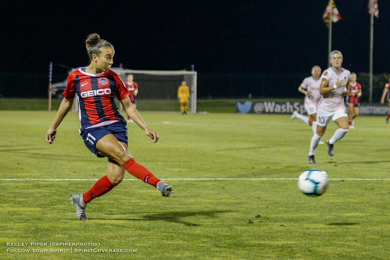 Washington Spirit forward Mallory Pugh (11) crosses the ball into the box at Maureen Hendricks Field in Boyds, MD, on July 20, 2019.