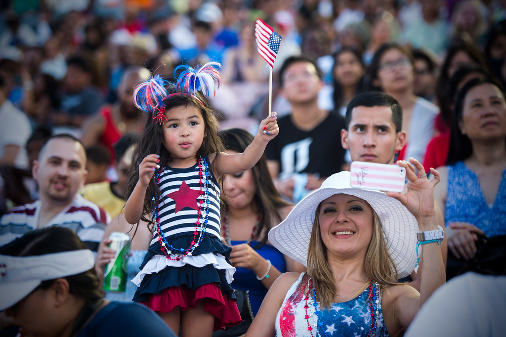 . Sandy Oak, of Rancho Cucamonga, and her 4-year-old daughter Jaely attend the 88th Annual Fourth of July Celebration, Americafest as they watch Ian Thomas perform at the Rose Bowl in Pasadena Friday night, July 4, 2014. (Photo by Sarah Reingewirtz/Pasadena Star-News)