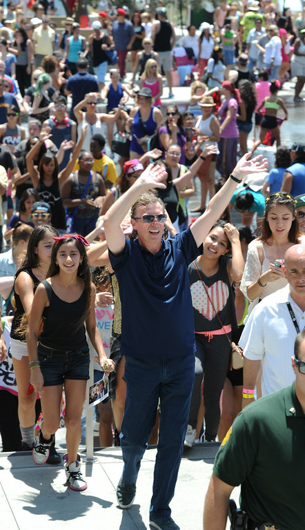 """. Nigel Lythgoe, co-creator and executive producer of \""""So You Think You Can Dance\"""" leads a group through Grand Park toward the Dorothy Chandler Pavilion during the 5th Annual National Dance Day celebration at Grand Park and The Music Center. More than 2,000 people participated in the free all-day dance extravaganza.  Los Angeles CA. 7/25/2014(Photo by John McCoy Daily News)"""